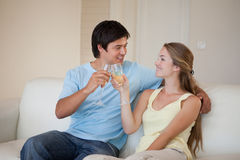 Couple drinking a glass of sparkling wine Royalty Free Stock Photos