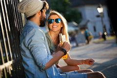 Couple drinking and having fun in the city. Summer holidays and dating concept. Summer holidays and dating concept. Couple drinking and having fun in the city stock image