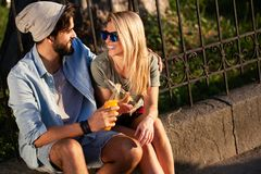 Couple drinking and having fun in the city. Summer holidays and dating concept. Summer holidays and dating concept. Couple drinking and having fun in the city royalty free stock image