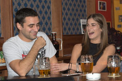 Couple drinking and having fun together.  stock photo