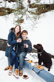 Couple drinking hot drink outdoors Royalty Free Stock Photography