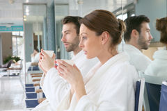 Couple drinking hot tea after relaxation in the spa Royalty Free Stock Images