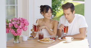 Couple drinking iced tea at breakfast outside Stock Photography