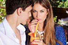 Couple drinking juice outdoor Stock Photos