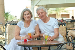 Couple drinking juice Stock Images
