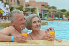 Couple drinking juice Royalty Free Stock Photography