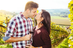 Couple drinking and kissing in a vineyard Royalty Free Stock Image