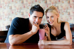 Couple Drinking Milkshake Royalty Free Stock Photos