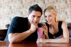 Couple Drinking Milkshake Royalty Free Stock Photos