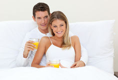 A couple drinking orange juice Royalty Free Stock Image