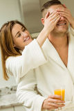 Couple drinking orange juice in bathrobes Stock Photography