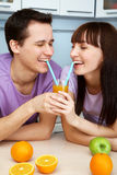 Couple drinking orange juice in the kitchen Stock Photography