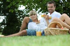 Couple drinking orange juice Royalty Free Stock Photos