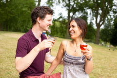 Couple drinking in the park Royalty Free Stock Images