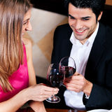 Couple drinking red wine clinking glasses Stock Photo