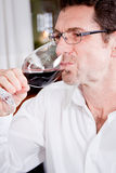 Couple drinking red wine in restaurant Royalty Free Stock Photo