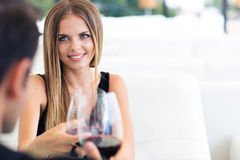 Couple drinking red wine in restaurant Stock Photos