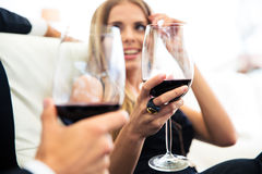 Couple drinking red wine in restaurant Stock Image