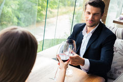 Couple drinking red wine in restaurant Stock Photo