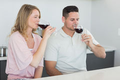 Couple drinking red wine at table Royalty Free Stock Image