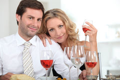 Couple drinking rose Stock Image