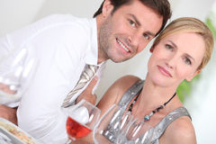 Couple drinking rose wine Stock Photography