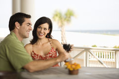 Couple Drinking and Smiling Royalty Free Stock Photography