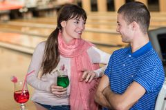 Couple drinking softs at table in bowling club Royalty Free Stock Images