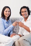 Couple drinking sparkling wine on the couch Stock Image