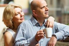 Couple drinking tea at balcony Royalty Free Stock Image