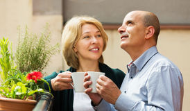 Couple drinking tea at balcony stock photo