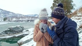 Couple drinking tea, coffee cup in the winter. Couple in love drinking tea, coffee cup in the winter forest. Slow motion stock video