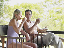 Couple Drinking Tea And Juice On Terrace Royalty Free Stock Image
