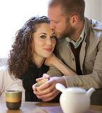 Couple is drinking tea in the living room. stock photos