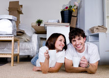 Couple drinking tea in new home Stock Images