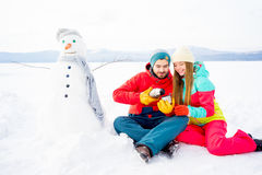 Couple drinking tea outdoors in winter Stock Photos