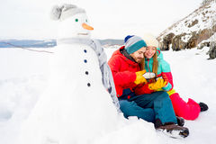 Couple drinking tea outdoors in winter Stock Image