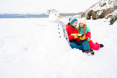 Couple drinking tea outdoors in winter Royalty Free Stock Images