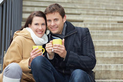 Couple drinking tea on stairs Royalty Free Stock Images