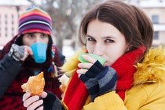 Couple drinking tea in winter Royalty Free Stock Photos
