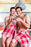Couple drinking Turkish tea in wellness spa Stock Images