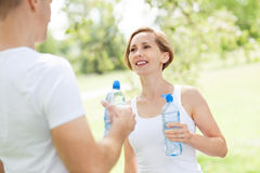 Couple drinking water after exercise Royalty Free Stock Image