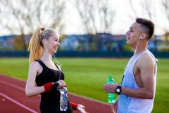 Couple drinking water after workout Royalty Free Stock Photography