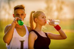 Couple drinking water Stock Photos