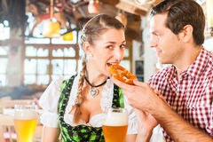 Couple drinking wheat beer in Bavarian restaurant Stock Image