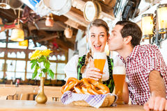 Couple drinking wheat beer in Bavarian restaurant Royalty Free Stock Images