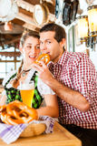 Couple drinking wheat beer in Bavarian restaurant Stock Photo