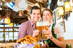 Couple drinking wheat beer in restaurant Royalty Free Stock Photo