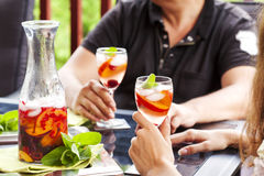 Couple drinking white sangria. White sangria with fruits and berries Stock Photography