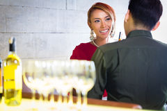 Couple drinking white wine in fancy bar Stock Photos